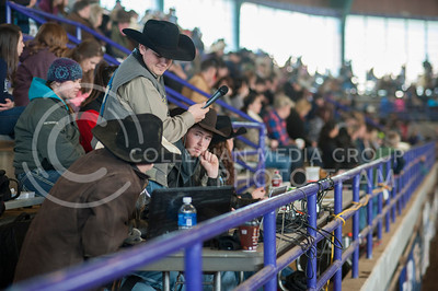 Announcer Kory Keeth looks to his officials before saying the score of a rider during Sundays finals at the K-State Rodeo at Weber Arena. (Evert Nelson | Collegian)