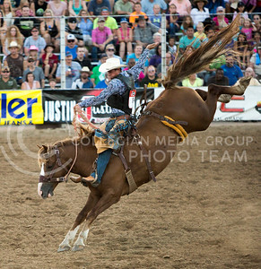 Saddle bronc rider Wyatt Barstow of Springview, Nebraska rides Lucky Lady at the Kaw Valley PRCA Rodeo in CiCo Park on July 23, 2015.
