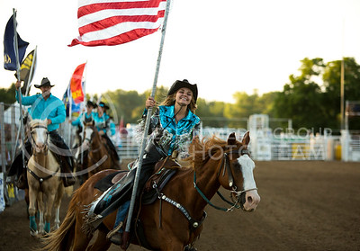 Cassie Goering, member of the McPherson Silver Buckle Drill Team, presents the colors during the opening ceremony at the Kaw Valley Rodeo in CiCo Park on July 23, 2015.