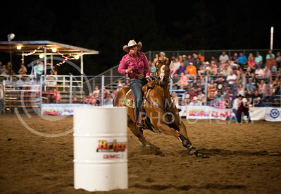 Barrel racer Kyra Stierwalt of Oklahoma prepares to round the barrel at the Kaw Valley PRCA Rodeo in CiCo Park on July 23, 2015.