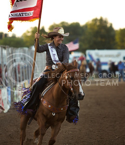 2015 Miss Rodeo K-State Allie Dwyer carries the Manhattan flag at the Kaw Valley Rodeo in CiCo Park on July 23, 2015.