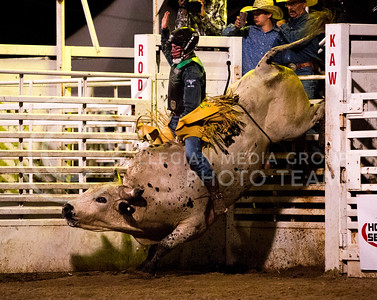 Bull rider Jake Gowdy of Bistrow, Oklahoma hold on tight to Patriot Pride at the Kaw Valley PRCA Rodeo in CiCo Park on July 23, 2015.