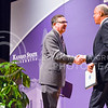 K-State President Kirk Schulz, left, shakes hands with U.S. Secretary of Homeland Security Jeh Johnson after introducing Johnson as the Landon Lecturer May 27, 2015, in Forum Hall in the K-State Student Union. (Parker Robb | The Collegian)