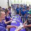 "K-State fans line up to receive free K-State football and volleyball posters at ""K-State Day at the K"" during the Kansas City Royals vs Texas Rangers game June 7, 2015, at Kauffman Stadium in Kansas City, Missouri. (Parker Robb 
