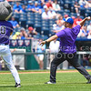 "K-State head soccer coach Mike Dibbini throws the ceremonial first pitch of the Kansas City Royals vs Texas Rangers game during ""K-State Day at the K"" June 7, 2015, at Kauffman Stadium in Kansas City, Missouri. (Parker Robb 