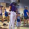 "Tall Willie poses with a young K-State fan at ""K-State Day at the K"" during the Kansas City Royals vs Texas Rangers game June 7, 2015, at Kauffman Stadium in Kansas City, Missouri. (Parker Robb 