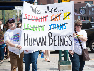 Manhattan community members participate at the Little Apple Pride Parade in Aggieville on April 11, 2015. (Cassandra Nguyen | The Collegian)