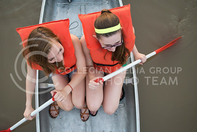 Rachel Nyhart, senior in anthropology and English, and Jamie Teixeira, senior in English, maneuver around Tuttle Creek Lake during the rowing bucket-list adventure on July 9, 2015. (George Walker | The Collegian)