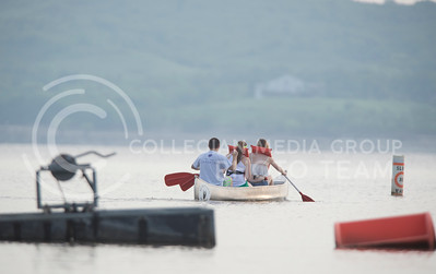 (Left to right) Rachel Nyhart, senior in anthropology and English, Jamie Teixeira, senior in English, and Brandon Bienhoff, senior in construction science and management, row out on Tuttle Creek Lake during the canoeing bucket-list on July 9, 2015. (George Walker | The Collegian)