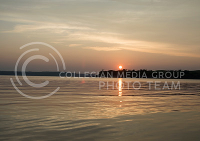 The sun sets over Tuttle Creek Lake at the end of the canoeing bucket-list adventure on July 9, 2015. (George Walker | The Collegian)