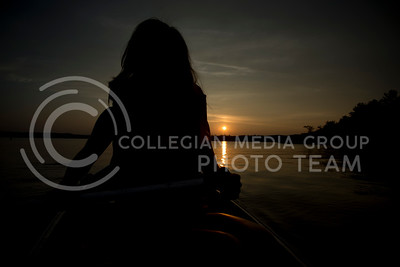 The sunset silhouettes Rachel Nyhart, senior in anthropology and English, at the end of the canoeing bucket-list adventure on July 13, 2015. (George Walker | The Collegian)