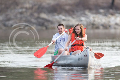 Rachel Nyhart, senior in anthropology and English, Jamie Teixeira, senior in English (not visible), and Brandon Bienhoff, senior in construction science and management, row to the dock at Tuttle Creek Lake on July 9, 2015. (George Walker | The Collegian)