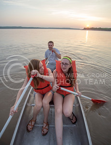 Rachel Nyhart, senior in anthropology and English, Jamie Teixeira, senior in English, and Brandon Bienhoff, senior in construction science and management maneuver around Tuttle Creek Lake during the rowing bucket-list adventure on July 9, 2015. (George Walker | The Collegian)