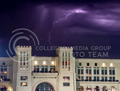 Lightning fills the sky behind the West Stadium Center of Bill Snyder Family Stadium early May 3, 2015. (George Walker | The Collegian)