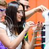 From left, David Madden, Leticia Peres Multini, and Lucas Ramon, all juniors in chemical engineering, measure the concentration of acetone at different heights as it evaporates and rises up a PVC tube in Transport Phenomena Lab March 11, 2015, in Durland Hall. Representatives of the Colleges of Engineering, Education and Human Ecology are debating increasing their per-credit-hour fees already tacked onto the regular K-State tuition rate next school year. (Parker Robb | The Collegian)