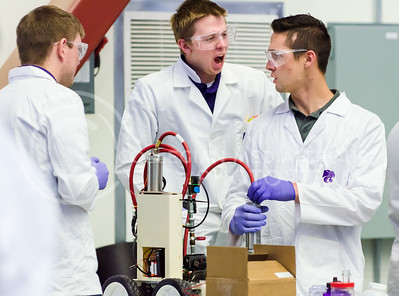 Ben Williams shouts emphatically at Levi Karhoff, both juniors in chemical engineering, after the pressure-driven car team took the lead by stopping their car closest to the line in the first of two rounds at the ChemE Car competition Saturday at KU. (Parker Robb   The Collegian)