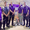 Members of the pressure car subteam of the K-State ChemE Car Team stand with the car they built and refined over the last school year at the poster presentation of the American Institute of Chemical Engineers regional student conference at KU in Lawrence Saturday. The team won the competition with their car that propels itself via a piston reciprocated by gas generated by a chemical reaction, and is now headed to the national conference and competition in Salt Lake City in November. ChemE Car is a chemical engineering student design competition in which student teams must build a small vehicle that moves a set amount of water a certain distance. Competitors are not told the specific amount of water and the distance of travel until an hour before the competition. (Parker Robb | The Collegian)