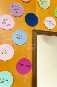 Parker Robb | The Collegian  Disney-themed paint chips on the closet door continue the multicolored polka-dot theme exhibited in Lisa Owsley's dorm room.