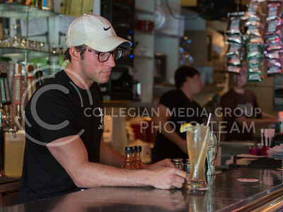 John Nail, senior in biochemistry, serves a drink at Rock-A-Belly Deli on June 23, 2015. Nail has worked at Rock-A-Belly for about a year. (George Walker | The Collegian)