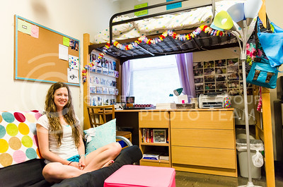 Parker Robb | The Collegian  Lisa Owsley, junior in bakery science, personalized and made her room in Boyd Hall more homey by supplying furnishings form her room back home and covering the walls around her desk with photos of friends and family.
