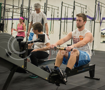 Taran Carlisle, senior in kineseology, works out on an ergometer during the K-State CrossFit class on Feb. 18, 2015. (George Walker | The Collegian)