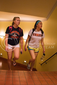 Michelle Haug, junior in marketing, and Erika Kramer, junior in apparell marketing, walk up the stairs in Hale Library from the downstairs entrance to the main floor. They both agree that it will make navigating the library easier if a new door is put in downstairs. (Taylor Alderman | The Collegian)