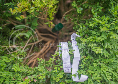 A geocache near the Bluemont Bell on June 22, 2015 contains the dates and names of those who have found it. Many different geocaches exist in Manhattan, including many on the K-State campus. (George Walker | The Collegian)