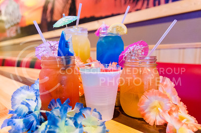 Parker Robb | The Collegian  Can't-miss drinks at Mojo's Beach Bar in Aggieville include, in the front from left to right, the Sharknado, Grenade  and Cantelope Bay, and in the back, Bananarama and Blue Hawaiian.