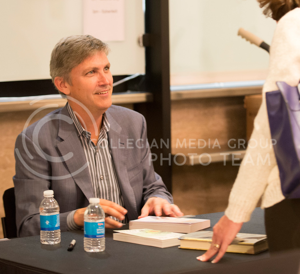 After his talk in McCain auditorum, Ghost Map writer, Steven Berlin Johnson signs copies of his books and chats with attendees in the lobby on Thursday night, Sept. 11, 2014. (Hannah Hunsinger | The Collegian)