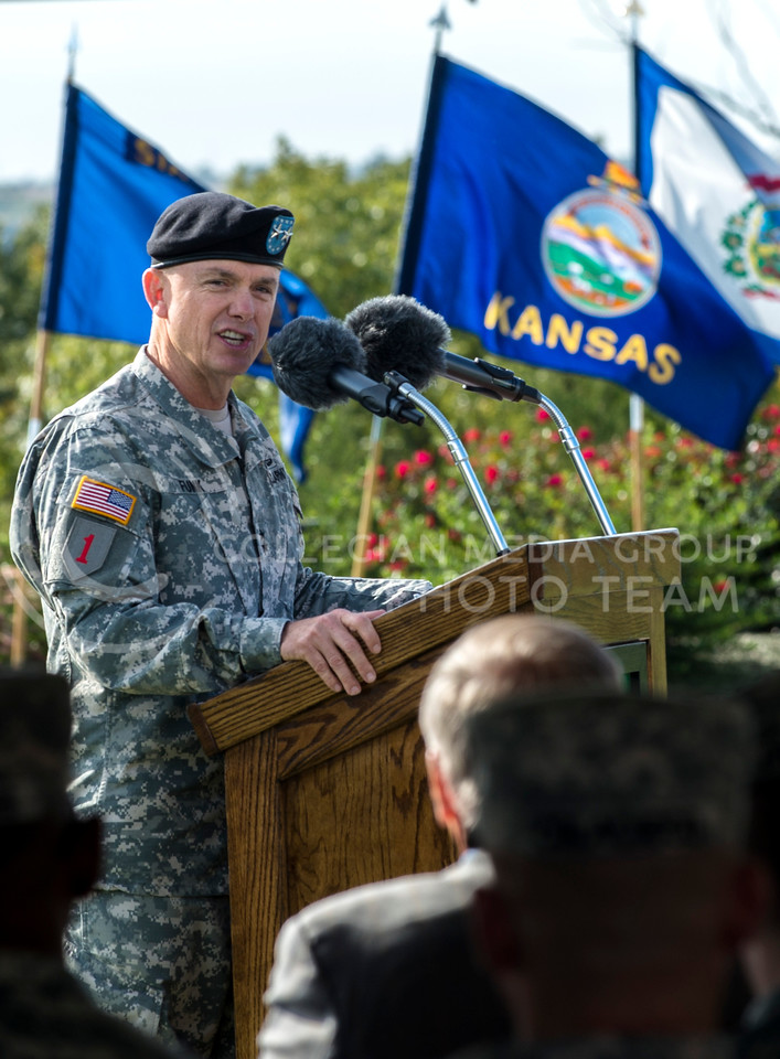 Maj. Gen. Paul E. Funk II, 1st Inf. Div. and Fort Riley commanding general address attendees to the casing ceremony on Fort Riley on Wednesday morning, Oct. 8, 2014.  The ceremony was symbolic of the soldiers being deployed to the Middle East out of Fort Riley. (Hannah Hunsinger | The Collegian)