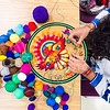 Cilau Valadez, of the Huichol indian tribe in Mexico, very carefully places yarn on his yarn painting during the College of Education's Mexican Art workshop February 17, 2015, in Bluemont Hall. (Parker Robb | The Collegian)