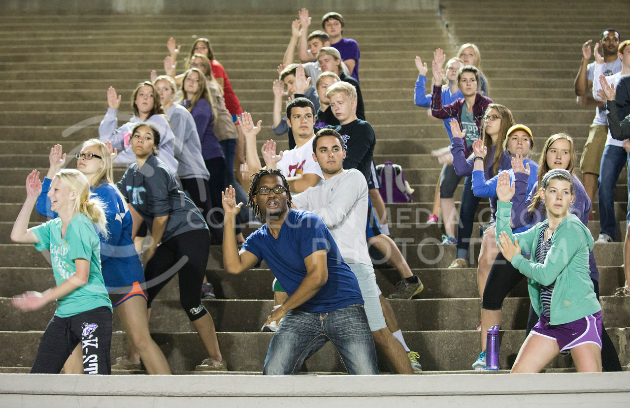 Men and women of Kappa Kappa Gamma, Pi Kappa Alpha, Phi Beta Sigma and Pi Kappa Phi practice for Pant the Chant in memorial stadium on Tuesday night, Oct. 7, 2014. (Hannah Hunsinger | The Collegian)