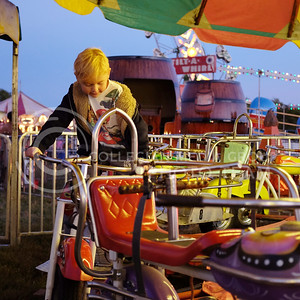 Ronan Farner, 7, on a carousal of motorcycles the evening of Oct. 3. at Fort Riley (Vail Moshiri | The Collegian)