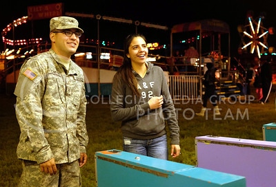 Carman and Celeste Carrano play skee-ball the night of Oct. 3. at the carnival taking place at Fort Riley. (Vail Moshiri | The Collegian)