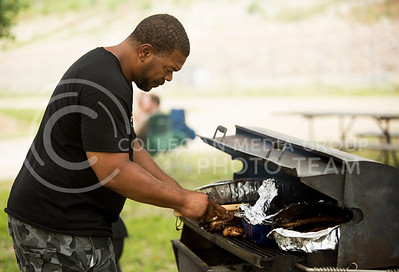 Lamar Fisher of Fishers BBQ from Tennessee, grills chicken and ribs at the Bayou GatorCraw Fest at Tuttle Creek State Park on July 18, 2015. (Emily Starkey | The Collegian)