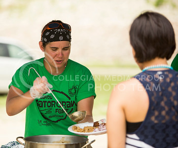 Lacey Salas, coach of the K-State women's rugby team, volunteers at the Bayou GatorCraw Fest at Tuttle Creek State Park on July 18, 2015. (Emily Starkey | The Collegian)