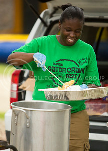 Shalondra Booker, former K-State basketball player, fries catfish and french fries at the Bayou GatorCraw Fest at Tuttle Creek State Park on July 18, 2015. (Emily Starkey | The Collegian)