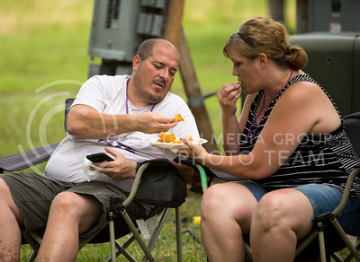 Chris and Jessica Delforge of Wamego share a plate of fried catfish at the Bayou GatorCraw Fest at Tuttle Creek State Park on July 18, 2015. (Emily Starkey | The Collegian)