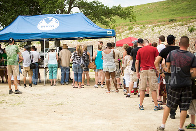 The crowd lines up to get a plate of jambalaya, frog legs and gator-on-a-stick at the Bayou GatorCraw Fest at Tuttle Creek State Park on July 18, 2015. (Emily Starkey | The Collegian)