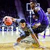 Junior guard Justin Edwards goes low attempting to circumnavigate West Virginia guard Daxter Miles, Jr., losing the ball in the process but not committing a turnover in the first half of the Wildcats' brutal 59-65 loss to the #17-ranked Mountaineers January 27, 2015, in Bramlage Coliseum. (Parker Robb | The Collegian)