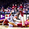 Sophomore guard Jevon Thomas collides with Iowa State players while diving for a loose ball in the first half of the Wildcats' 70-69 toppling of the #12-ranked Cyclones February 28, 2015, in Bramlage Coliseum. (Parker Robb | The Collegian)