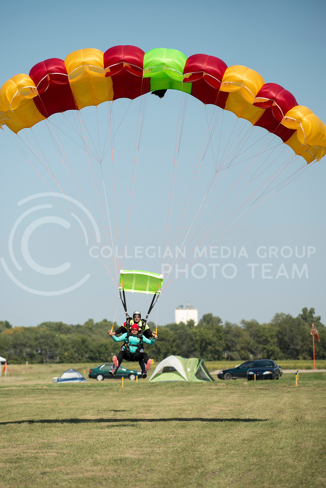 Maria Garcia, sophomore in pre-dental at Highland Community College, comes in for a landing with tandem instructor Troy Barnt, of McPherson, KS, at the Abilene Municipal Airport on Friday morning, Sept. 26, 2014. (Hannah Hunsinger | The Collegian)