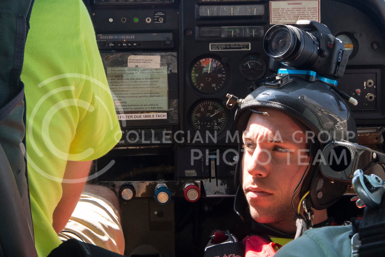 Instrctor Aaron Mitcell, of Kansas City, MO, relaxes in the KSUPC's Cessna 182 on the way up to 10,000 feet to film a tandem jump over Abilene, KS, on Friday morning, Sept. 26, 2014. (Hannah Hunsinger | The Collegian)