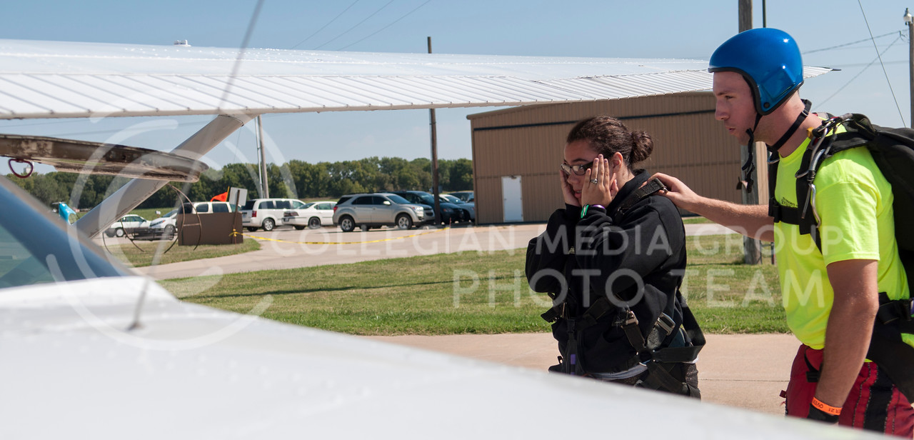 "Katie Rose McKinley, freshman in bio-chemistry, pauses with apprehension before boarding the KSUPC's Cessna 18 for her tandem skydive with tandem skydiving instructor Aaron Mitchell, of Kansas City, MO, in Abilene, KS on Friday morning, Sept. 26, 2014.  After her jump McKinely said ""the view was great"" and she ""will do it again."" (Hannah Hunsinger 