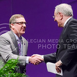 Steve Forbes, Chairman and Editor in Chief of Forbes Media, shakes hands with Kansas State University President Kirk Schulz prior to delivering the first Landon Lecture of 2015 Monday evenin ...
