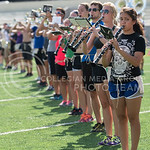 Leslie Gomez, senior in elementary education, and other marching band members rehearse the British Invasion halftime show in Memorial Stadium on Tuesday afternoon, Sept. 9, 2014. (Hannah Hunsinger | The Collegian)