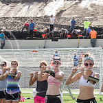 A line of piccolo players learn the British Invasion halftime show in Memorial Stadium while the ongoing stadium renovation goes on behind them, on Tuesday afternoon, Sept. 9, 2014. (Hannah Hunsinger | The Collegian)