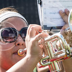 Elida Escarcega, junior in polictical science, holds up her music while learning the new Britist Invasion halftime show during marching band practice in Memorial Stadium on Tuesday afternoon, Sept. 9, 2014. (Hannah Hunsinger | The Collegian)