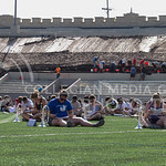 (Photo by Taylor Alderman | The Collegian)  Band members take a break at practice to look at new marching formations and recharge in the 95 degree heat on Tuesday afternoon, Sept. 9, 2014.