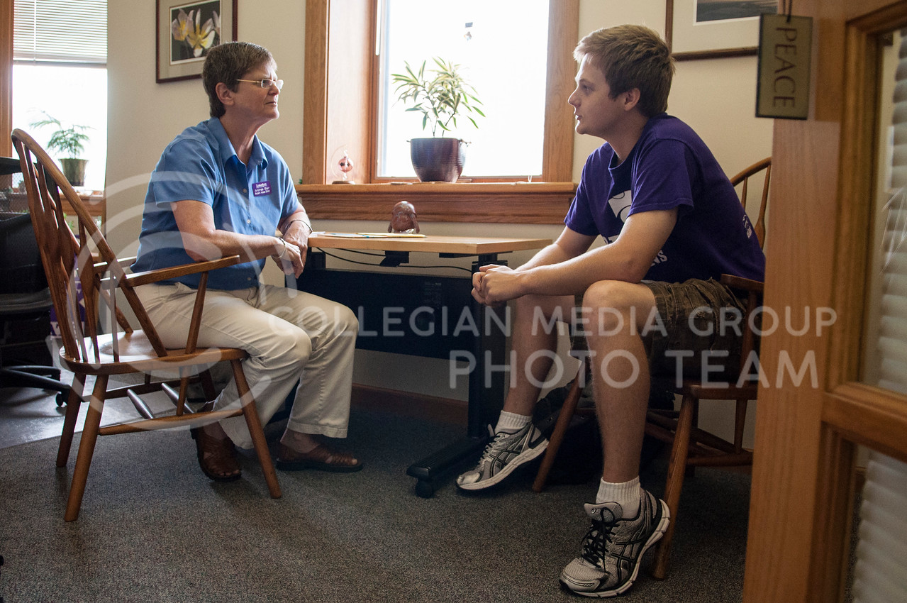 Andrea Blair, director of the Student Access Center, and Sam Roessler, senior in social sciences chat in Blair's office in Holton Hall on Wednesday afternoon, Sept. 10, 2014.  The Student Access Center is helps students with physcial and mental disabilities access all parts of college life. (Hannah Hunsinger | The Collegian)